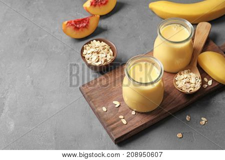 Jars with fruit protein shakes on table