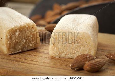 Marzipan bar in baking scene closeup with almonds