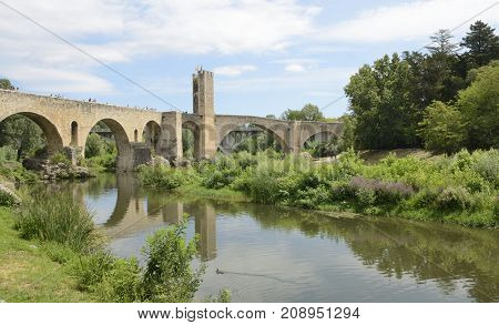 BESALU, SPAIN - JULY 26, 2017: Stone bridge of Besalu a medieval town of Girona Catalonia Spain.