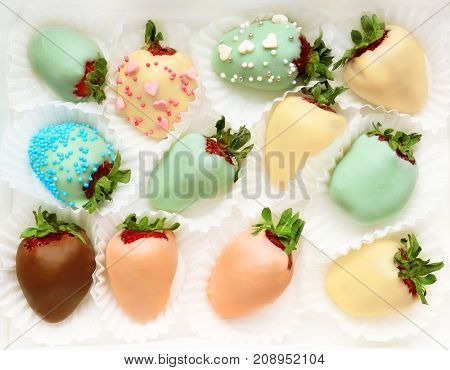Tasty chocolate dipped and glazed strawberries on white background