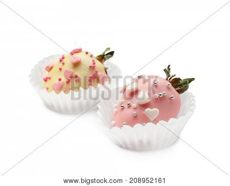 Tasty glazed strawberries with sprinkles on white  background