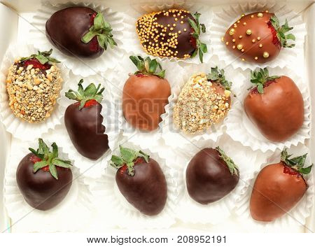 Box with tasty chocolate dipped strawberries, closeup
