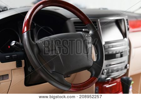 Steering wheel in modern car saloon