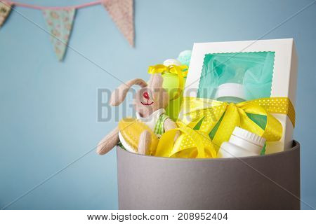Cardboard box with baby shower gifts indoors, closeup