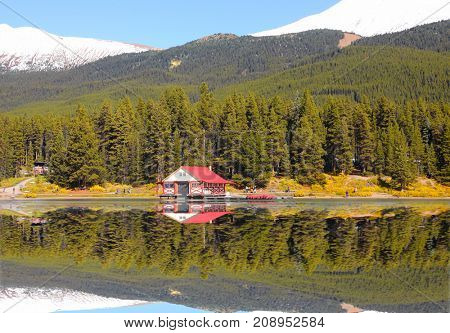 Perfect reflections of Maligne lake in Jasper national park Canada