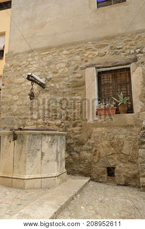 Stone water well in Besalu a medieval town of Girona Catalonia Spain.