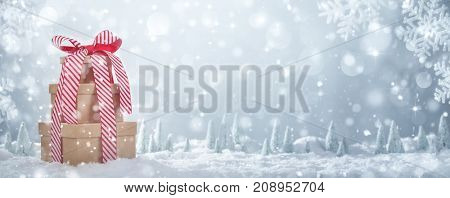 Stack of gift box on snow