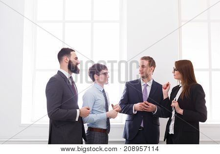 Managers meeting with the boss. Discuss the results of work, brainstorming. Teamwork concept. Business people in light white office interior, copy space