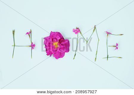 Word Home Written With Carnation And Wild Rose Flowers