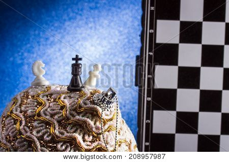 shine Christmas traditions board games and decorations popular chess and a Christmas tree toy on a blue background