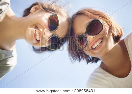 Two Cute Girl Smiling, Wearing Sunglasses