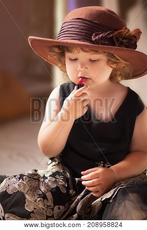 Little Girl Trying Mothers Lipstick. Growing Up Concept