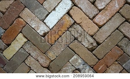 Zigzag diagonal lines of rustic color palette brick slabs