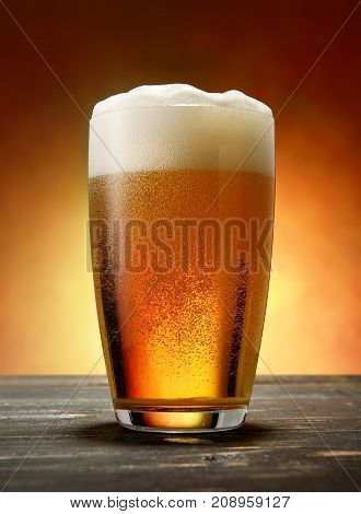 Glass of lager on a wooden table