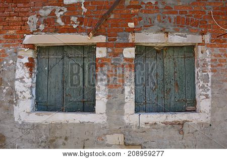 Windows in a disused residential building on the Venetian island of Giudecca