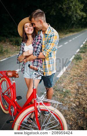 Love couple walk on vintage bikes romantic journey