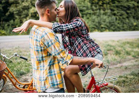 Man and woman kissing, romantic date, retro bikes