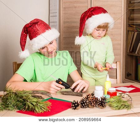 Children making Christmas decorations. Make christmas decoration with your own hands. Handcraft concept.