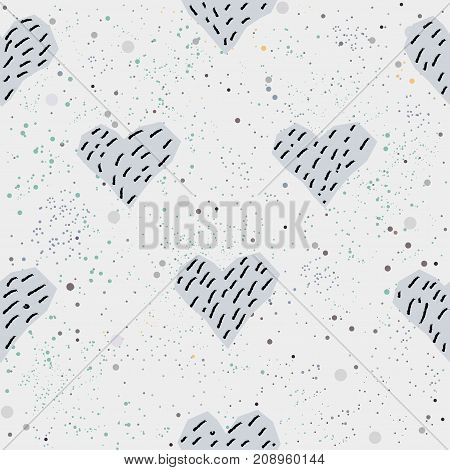Cute seamless pattern with hand drawn blue hearts on background with scattered dots