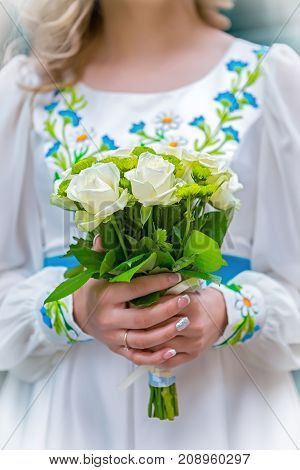 bouquet in the hands of the bride in the national Ukrainian dress
