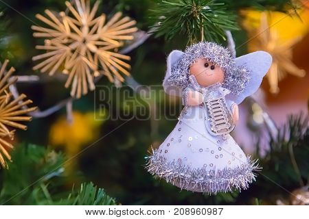 Christmas tree decoration, cute little angel playing on the harp