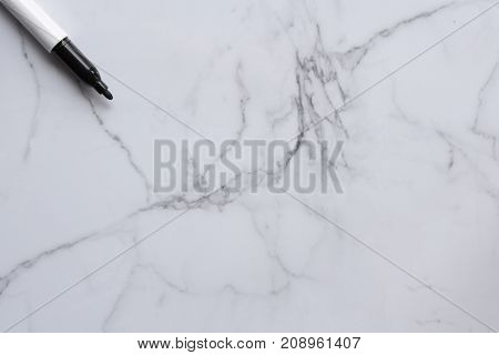 Blank marble white board with marker. Copy space.