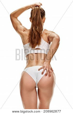 Young shapely athletic sexy woman touching her ass