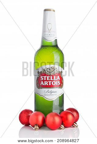 London, Uk - October 14, 2017: Cold Bottle Of Stella Artois Beer On White With Christmas Decoration