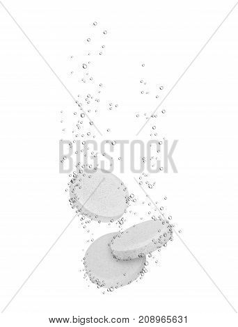 Three medical pills dissolves in water isolated on white background