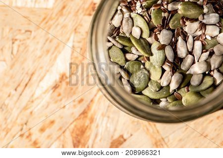 mason jar full of seeds healthy raw food mix of flax sesame pumpkin and sunflower seeds