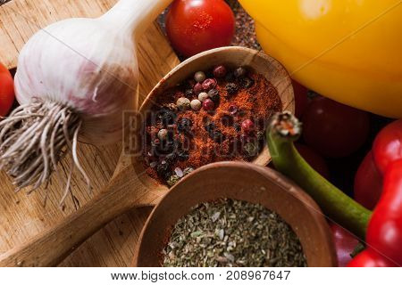 Hot spices. Culinary cuisine recipe background. Variety of pepper on wooden table, closeup. Menu, blog concept