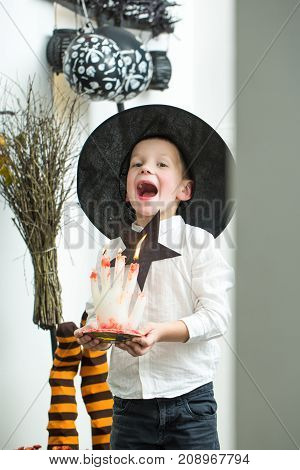 Halloween Kid With Bloody Candle.