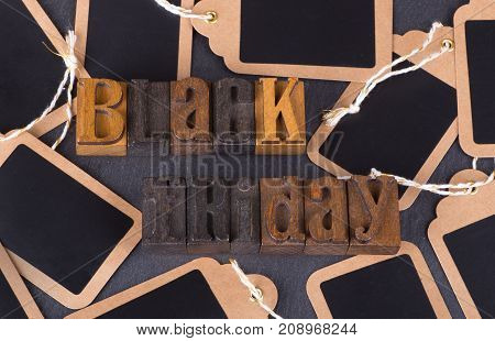 Black friday text with blank price tags on a black background