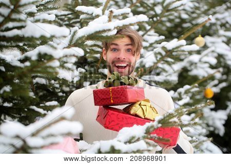 Man Smiling With Red Boxes In Snow Wood