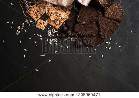 Food composition of breads products, close up top view. Quality sort of wholegrain bread and cookies, free space. Healthy morning snack concept