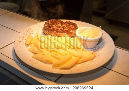 Chopped Steak And Pasta In A White Dish