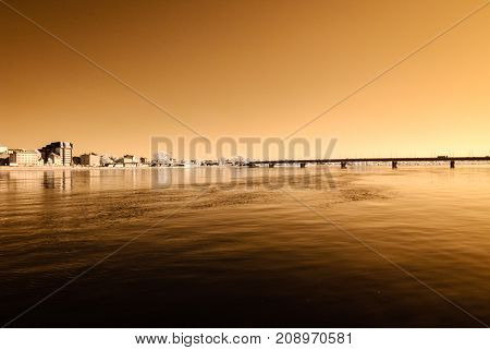 Panoramic View Of Riga, Latvia Over The River Daugava. Autumn Colors. Infrared Image