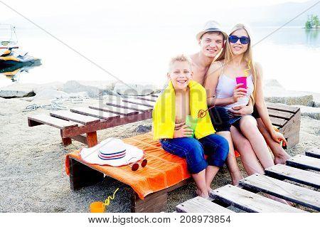 Family of three having fun on tropical beach