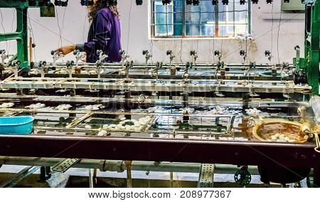 Suzhou, China - Nov 5, 2016: At Suzhou Number 1 Silk Factory; silk cocoon processing machine.