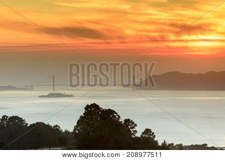Fiery Smoky Sunset over the Golden Gate Bridge. Grizzly Peak, Berkeley Hills, Alameda and Contra Costa Counties, California, USA.