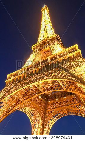 PARIS - 12 OCTOBER, 2017: Eiffel Tower in the Dusk on October 12, 2017. The Eiffel tower is the most visited monument of France located on Champs de Mars in Paris, France.