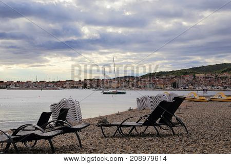 VODICE, CROATIA - SEPTEMBER 5, 2017: This is an empty beach of a Croatian seaside town on a gloomy autumn evening.