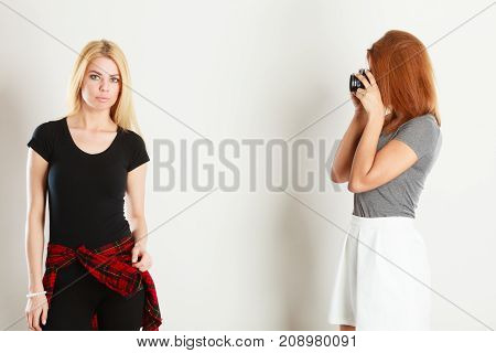 Mulatto Girl Photographing Blonde Woman