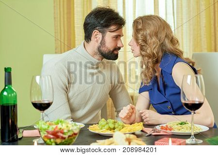 Romantic couple eating spaghetti. Beautiful woman and man. Love and share.