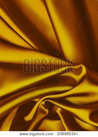 Rich gold silk background with copy space for text