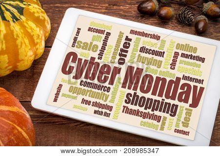 Cyber Monday word cloud  on a digital tablet  - a holiday online shopping concept