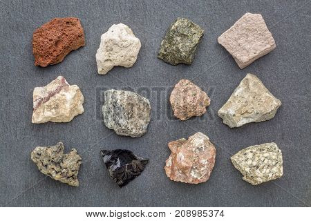 igneous rock geology collection, from top left: scoria, pumice, gabbro, tuff, rhyolite, diorite, granite, andesite, basalt, obsidian,  pegmatite, porphyry