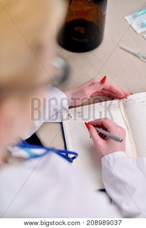 The doctor makes notes in your diary