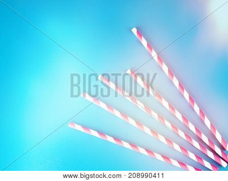 Drinking Straws For Party On Blue Pastel Background With Copy Space. Top View Of Colorful Paper Disp