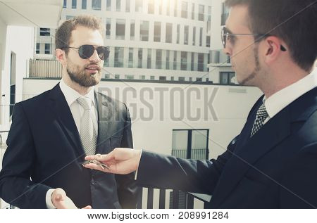 Young businessman investor buying new apartment. estate real agent property home investor young keys concept